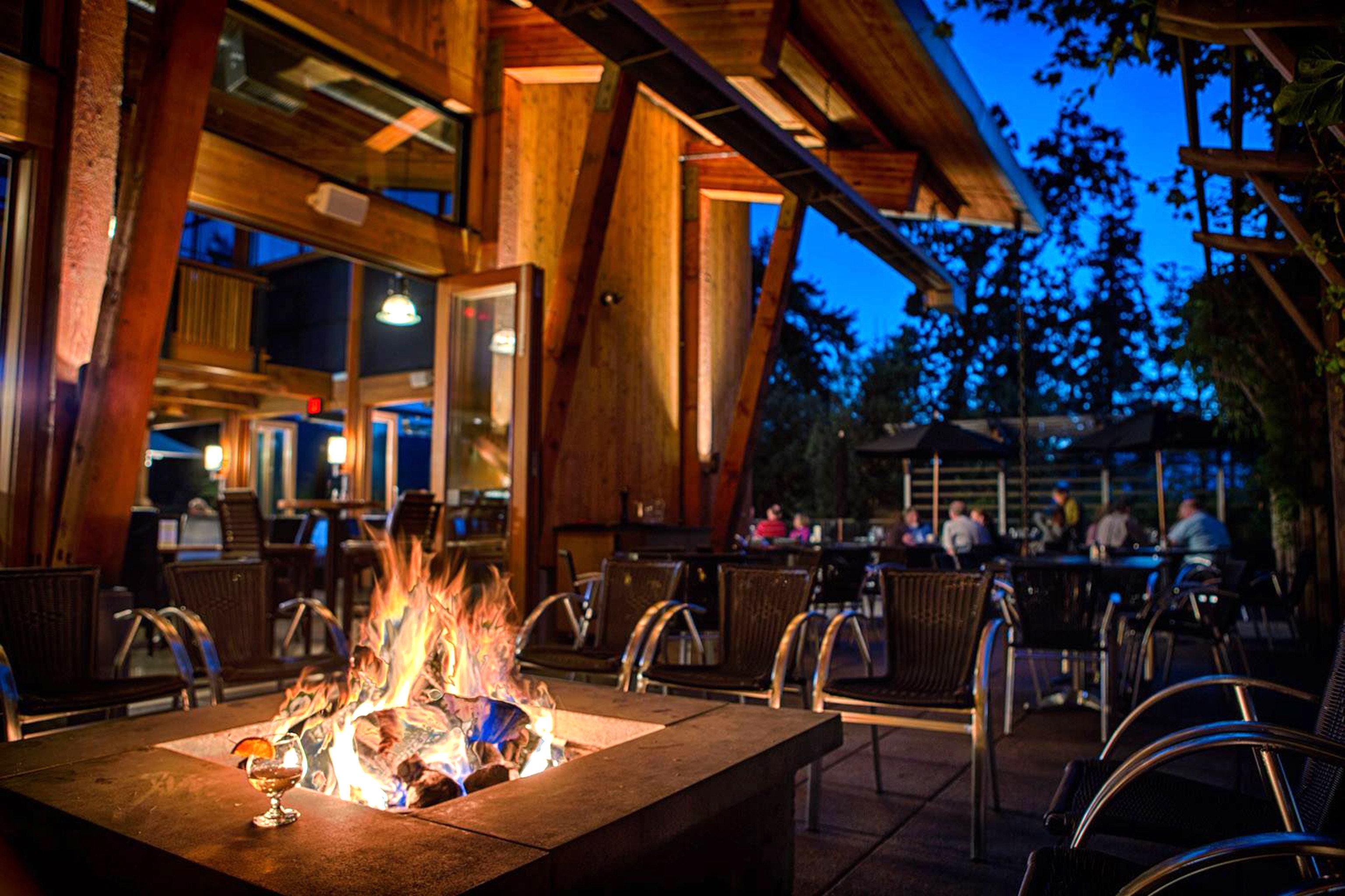 Firepit Modern Outdoor Activities Outdoors Resort Romantic Terrace Waterfront night lighting evening restaurant
