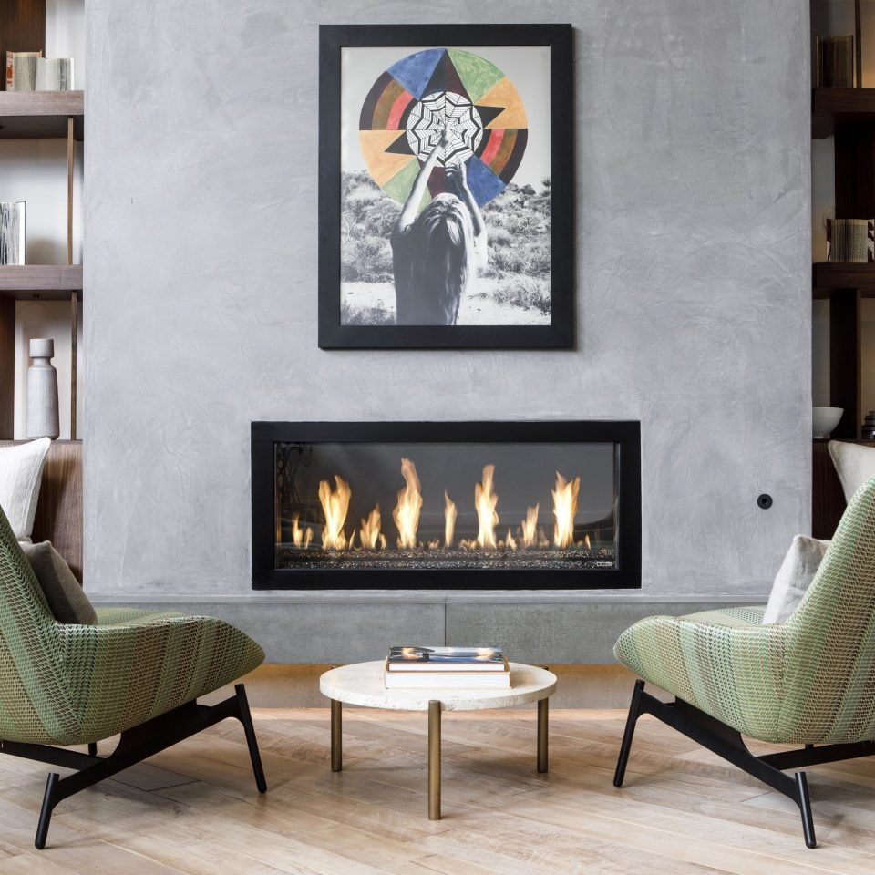 chair living room hearth Fireplace wood burning stove couch angle