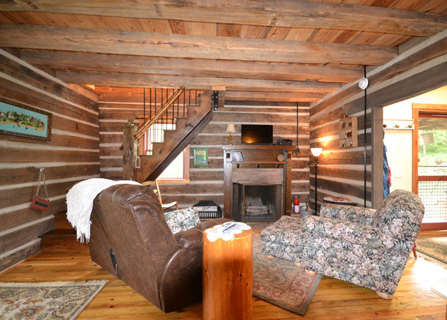 Fireplace log cabin property wooden cottage home hardwood living room attic beam farmhouse shed