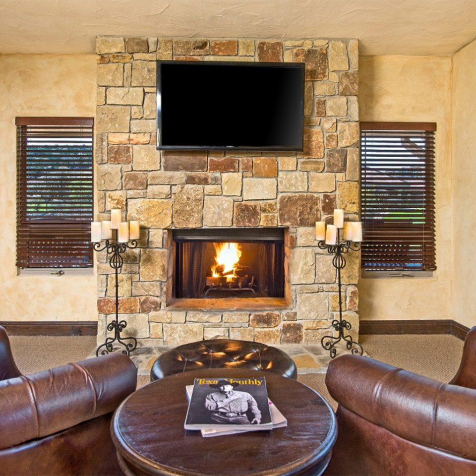Fireplace sofa fire leather chair property living room brown home hardwood cottage stone