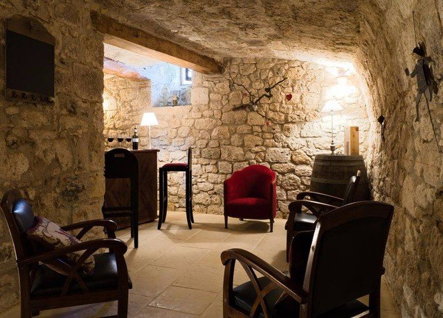 chair Fireplace property building cottage home living room farmhouse stone