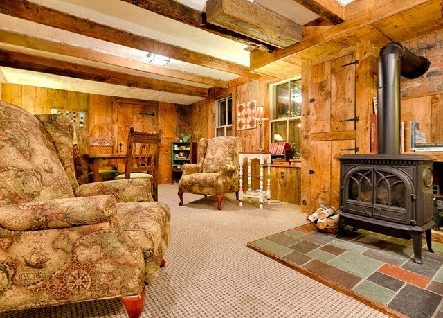 Fireplace living room property building log cabin home cottage hardwood farmhouse recreation room stone