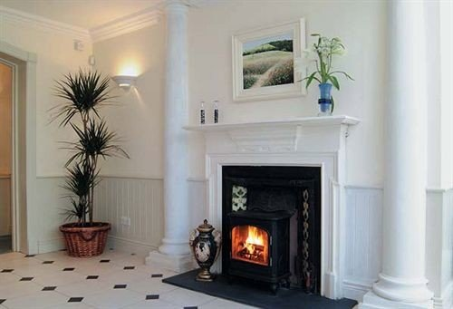 Fireplace fire property building hearth living room home cottage wood burning stove stone