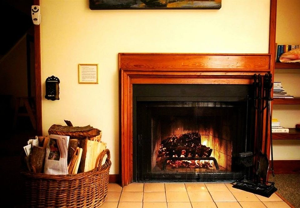 Fireplace fire hearth building living room home stone cottage wood burning stove