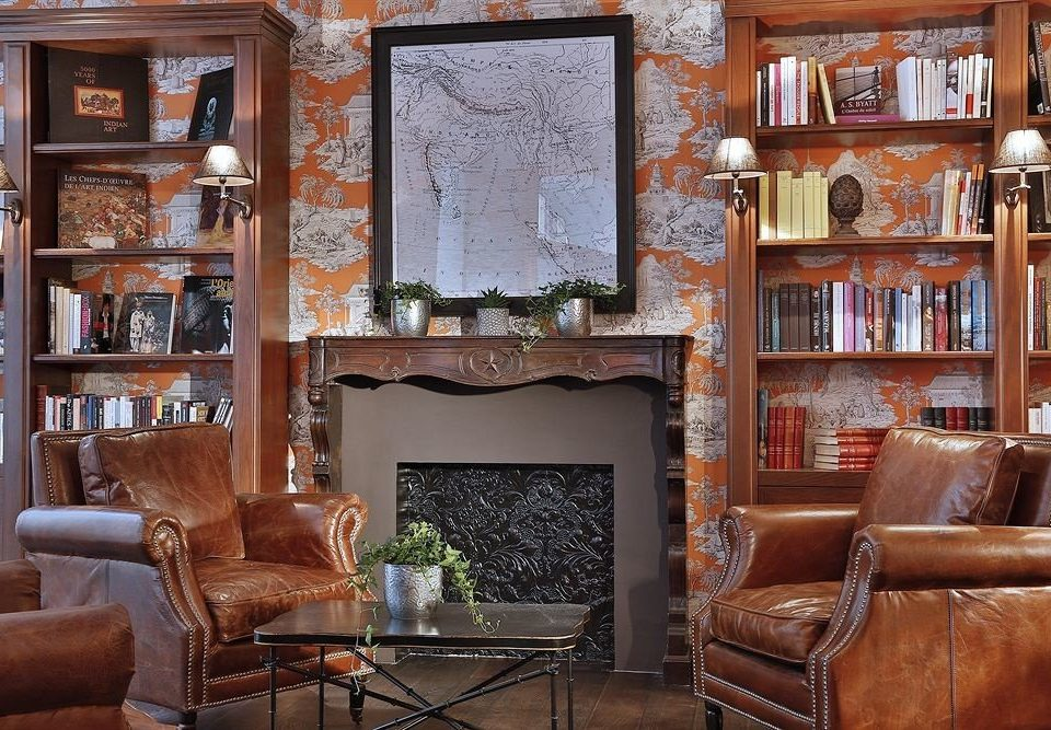 sofa chair living room shelf Fireplace property home house cabinetry cottage leather