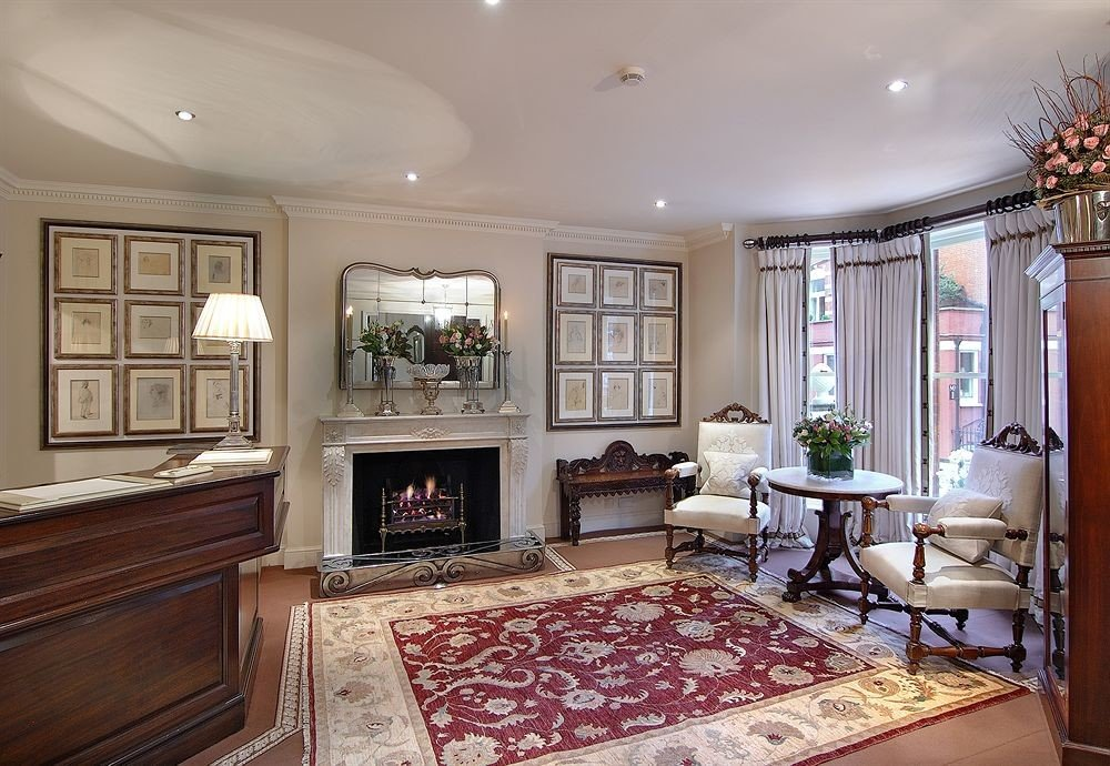 property Fireplace living room home hardwood rug cabinetry mansion cottage condominium