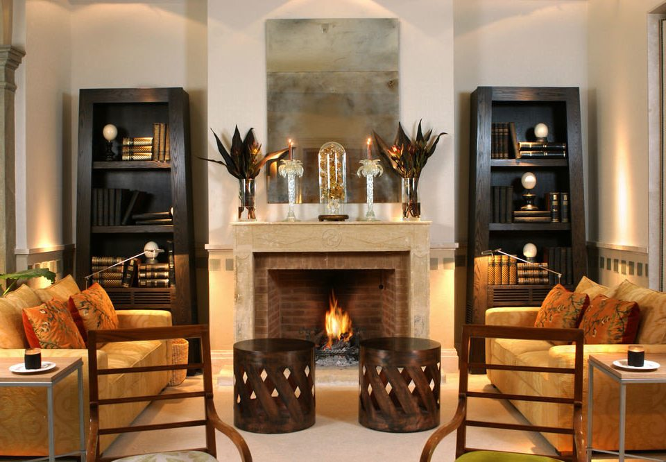 Fireplace hearth living room wood burning stove home hardwood cabinetry wood flooring cottage