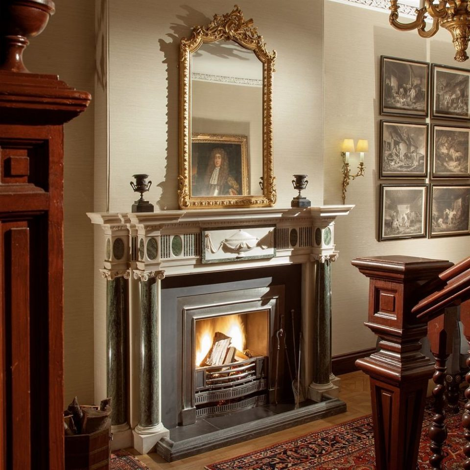 Fireplace fire hearth cabinetry hardwood living room