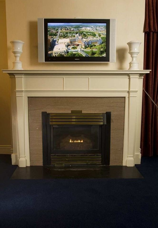 Fireplace television home hearth hardwood living room cabinetry flat