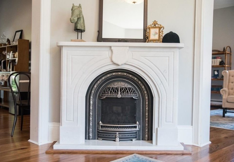 Fireplace hearth living room hardwood home cabinetry hard stone