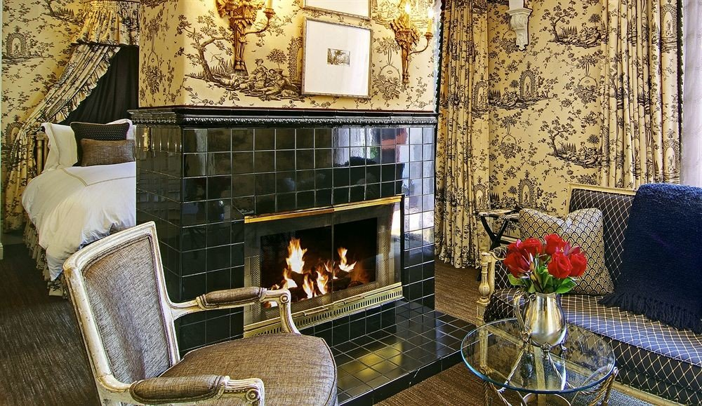 Fireplace chair house living room hearth home fire cottage stone tiled