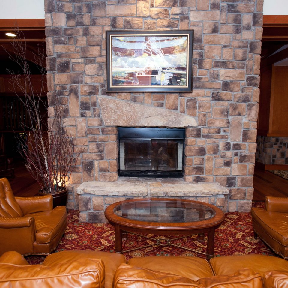 Fireplace sofa living room fire property chair home hearth hardwood cottage stone
