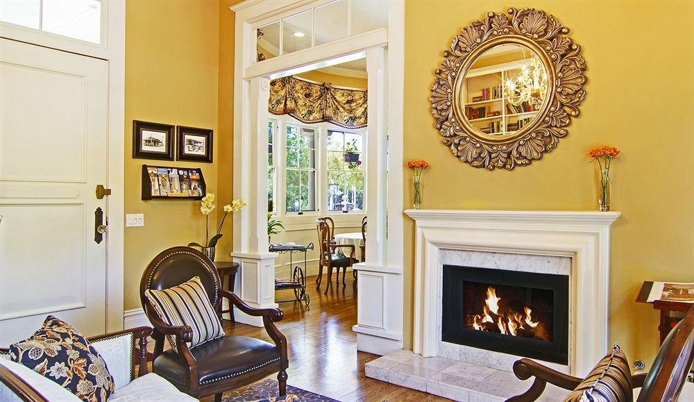 Fireplace fire property living room chair home hardwood cottage mansion