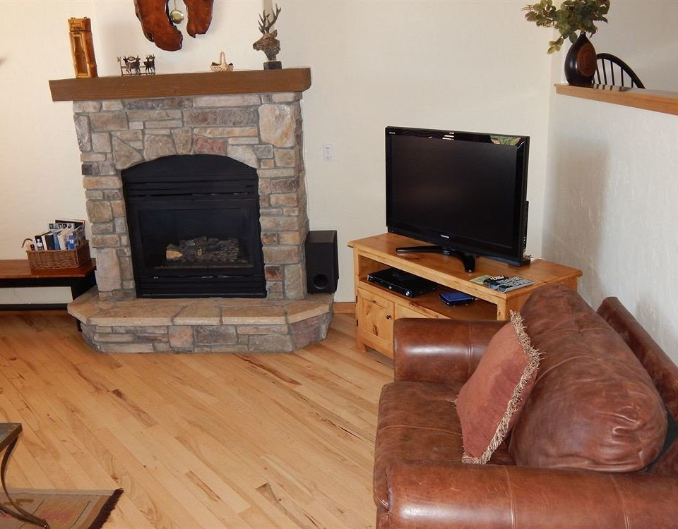 sofa Fireplace chair hearth property living room hardwood leather home cottage wood flooring