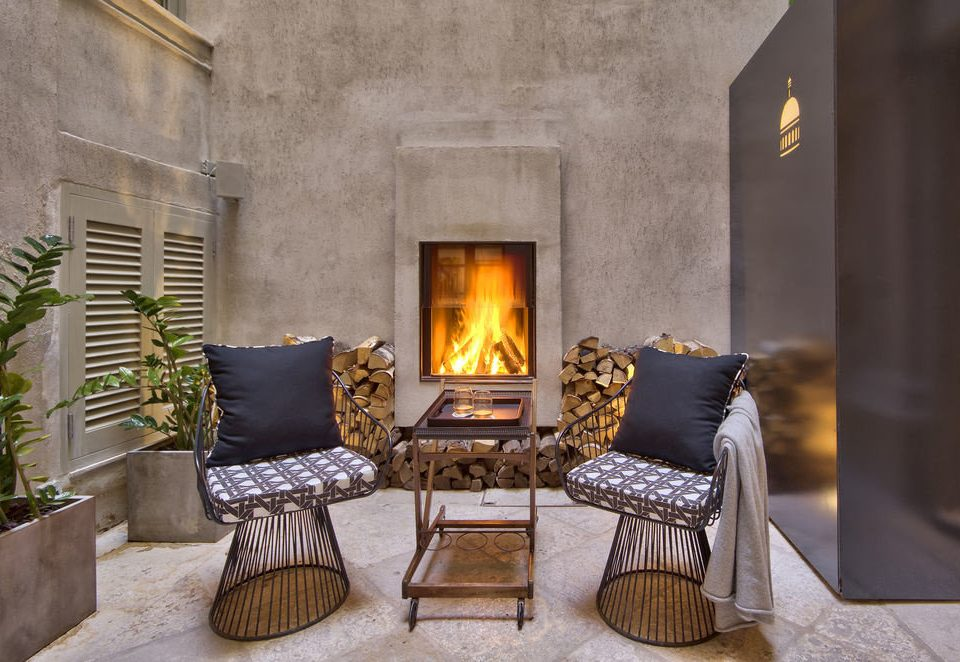 Fireplace hearth chair property living room home cottage stone mansion