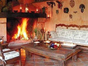 Fireplace fire property hearth cottage oven living room stone cooking