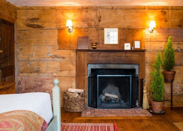 Fireplace fire property hearth cottage living room hardwood home farmhouse stone