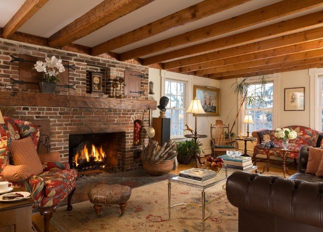 sofa Fireplace fire living room property home cottage log cabin farmhouse stone