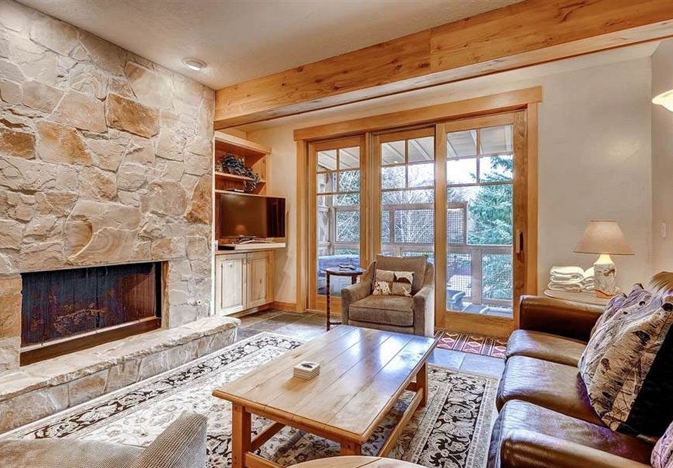 Fireplace sofa fire living room property home hardwood stone farmhouse cottage mansion log cabin