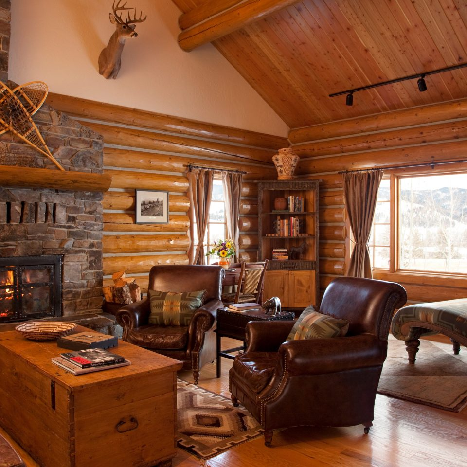 Fireplace property log cabin living room fire home house cottage hardwood farmhouse wood flooring stone