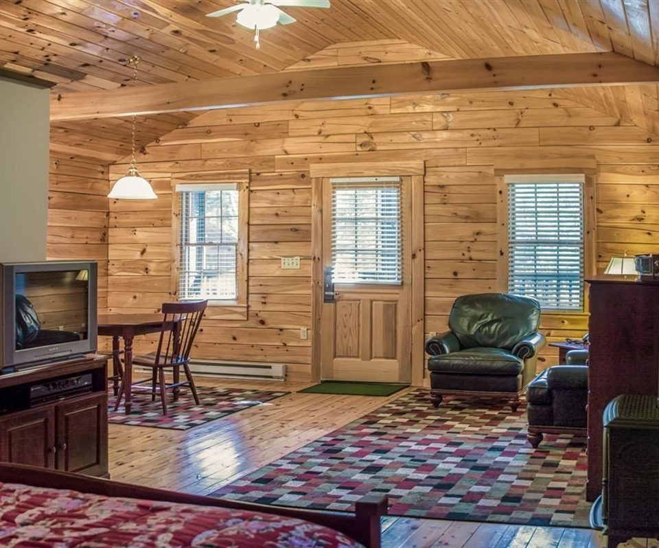 property log cabin rug living room home cottage hardwood farmhouse outdoor structure Fireplace porch