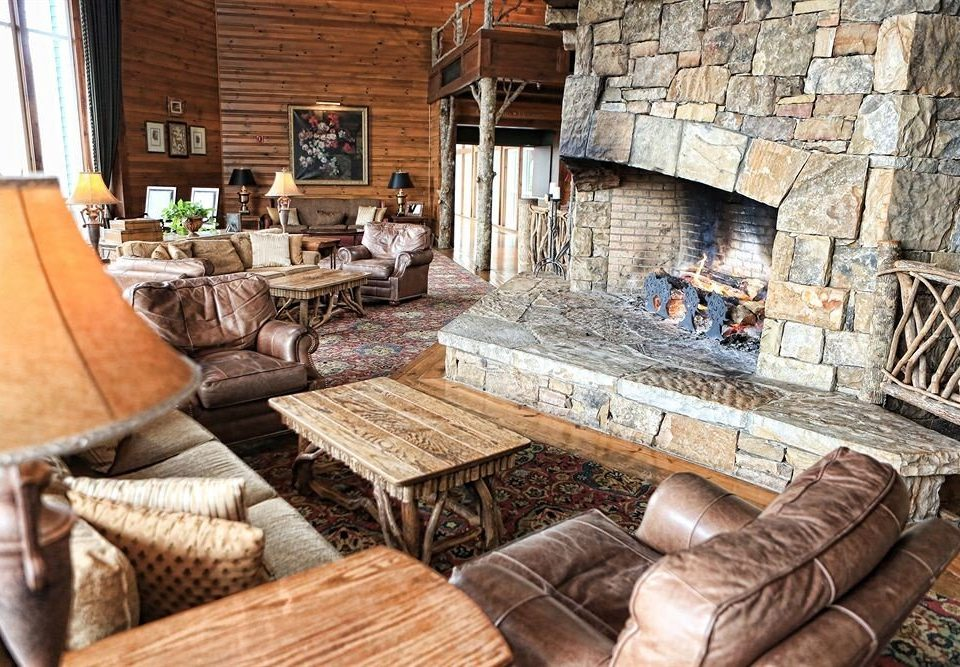 sofa property living room Fireplace home cottage stone farmhouse old log cabin leather