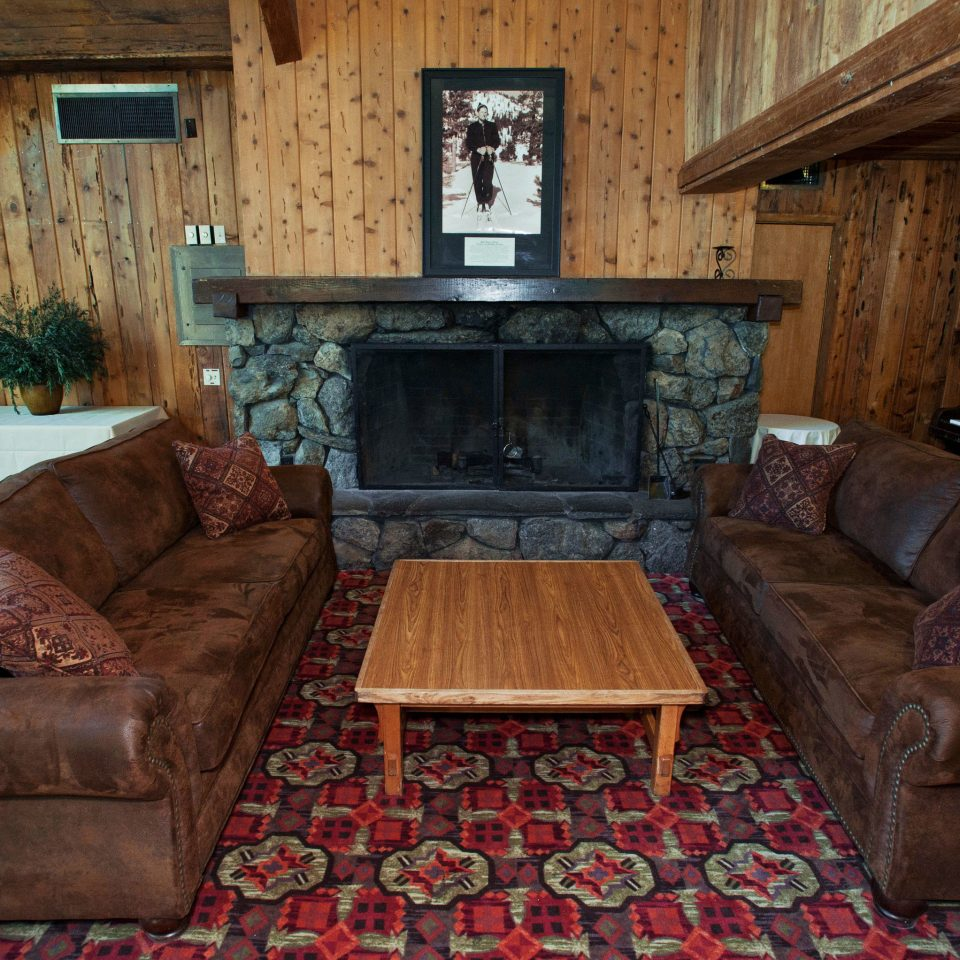 sofa living room property home house cottage log cabin Fireplace mansion screenshot farmhouse