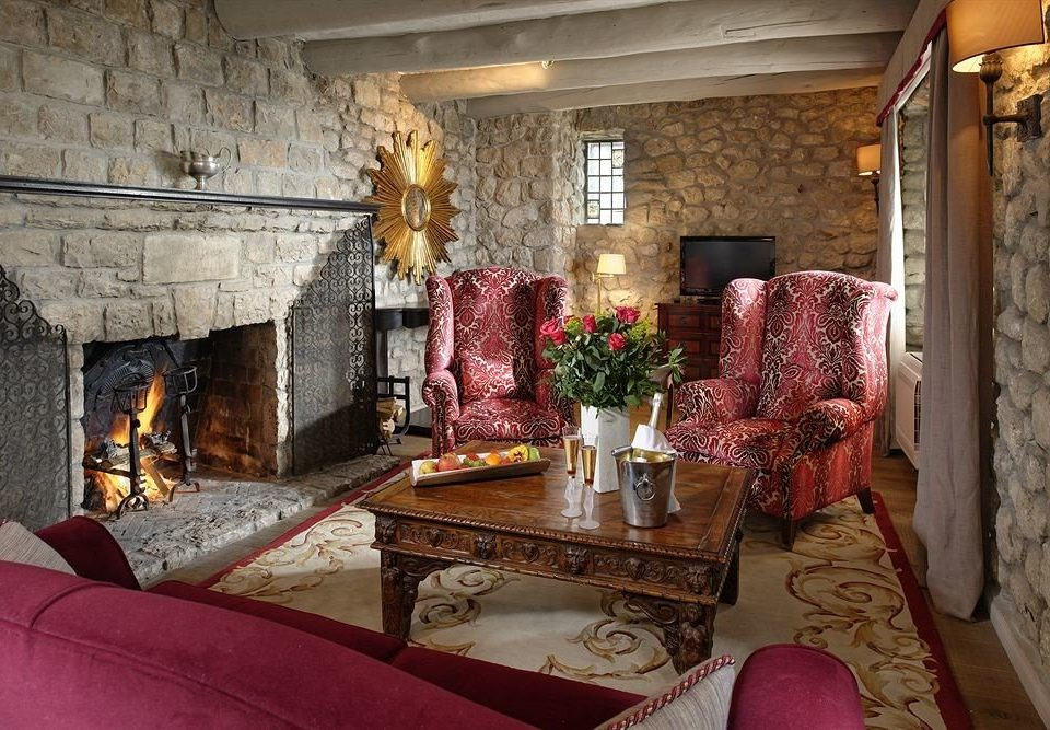 sofa Fireplace property living room fire house home cottage mansion stone