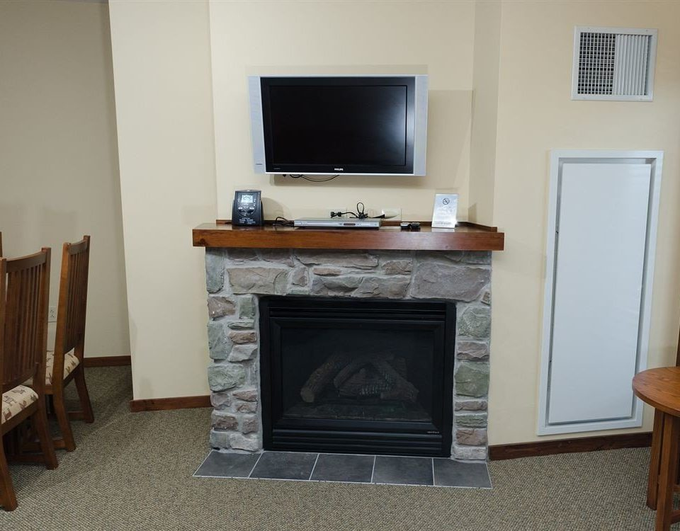 Fireplace television property hearth living room home hardwood cottage wood burning stove flat stone