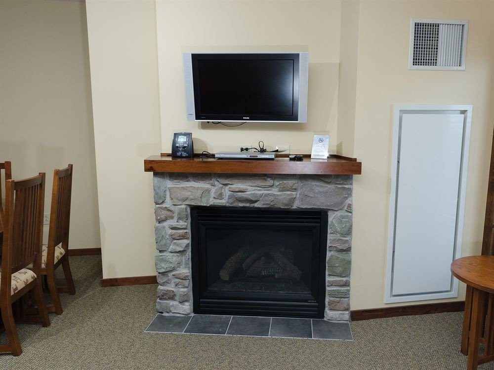 Fireplace television property hearth living room home hardwood cottage wood burning stove flat stone