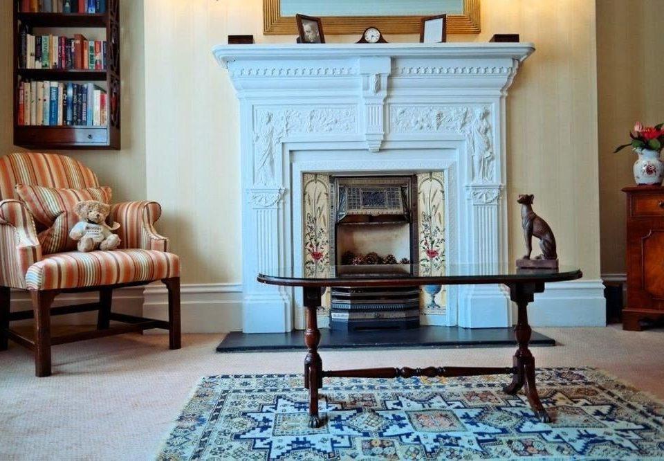 living room Fireplace property hardwood home flooring mansion hearth wood flooring shelf cottage