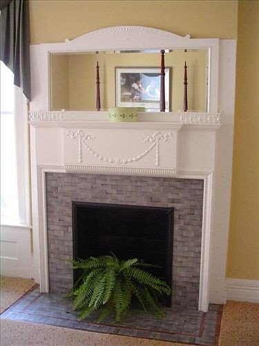 Fireplace property living room hardwood home cottage hearth stone
