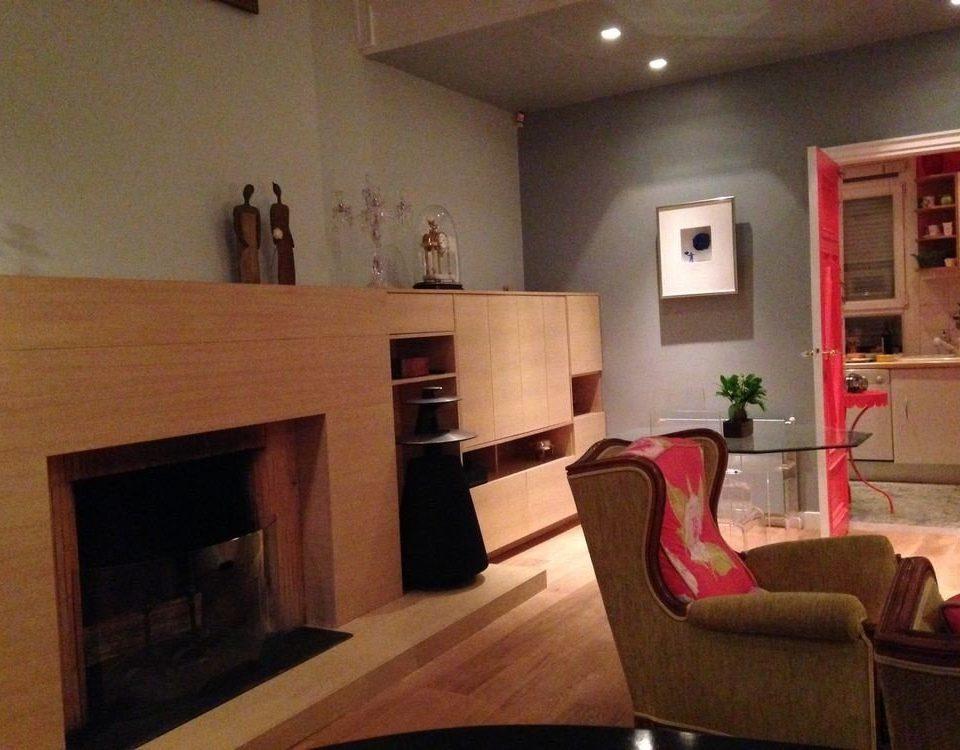 sofa property living room house home hardwood hearth cottage Fireplace loft