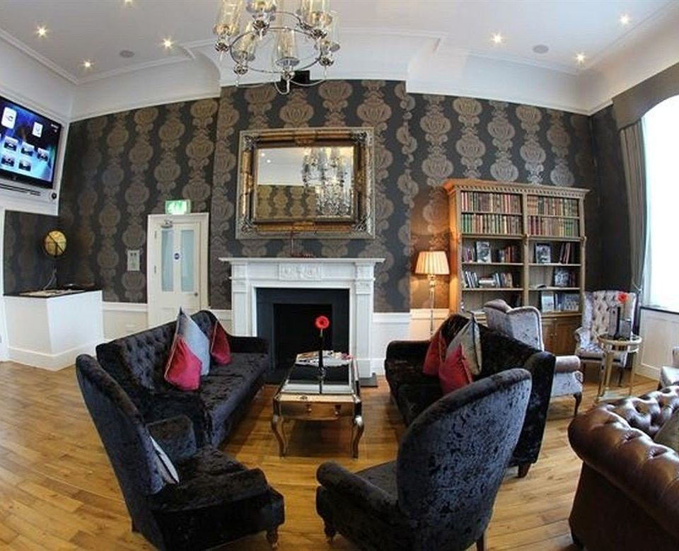 sofa living room property Fireplace home hardwood cottage mansion recreation room leather