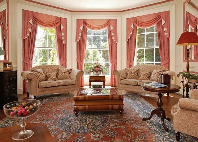 sofa living room property Fireplace home hardwood rug flooring window treatment wood flooring stone
