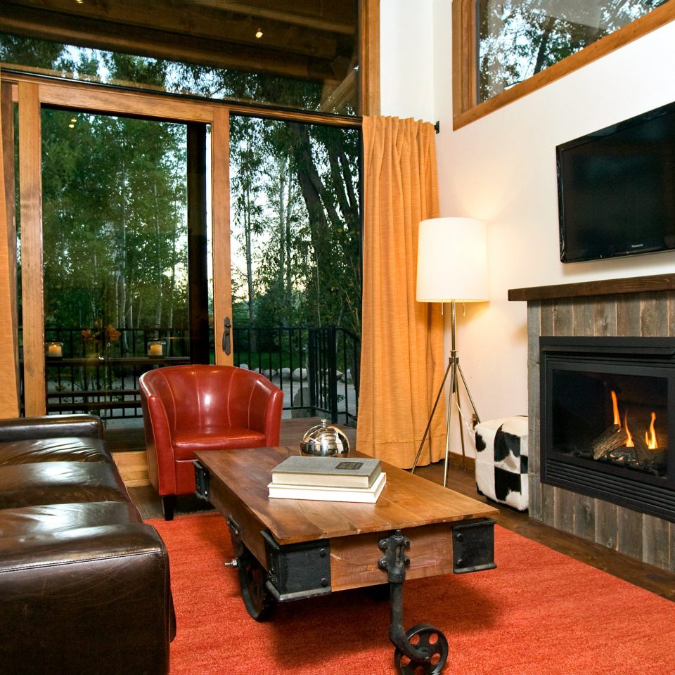 Fireplace Glamping sofa living room property building hearth home hardwood cottage Suite leather Villa flat