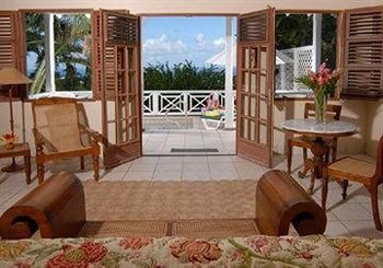 Hip Lounge Luxury Tropical property cottage living room home Fireplace Resort Villa condominium porch hacienda rug