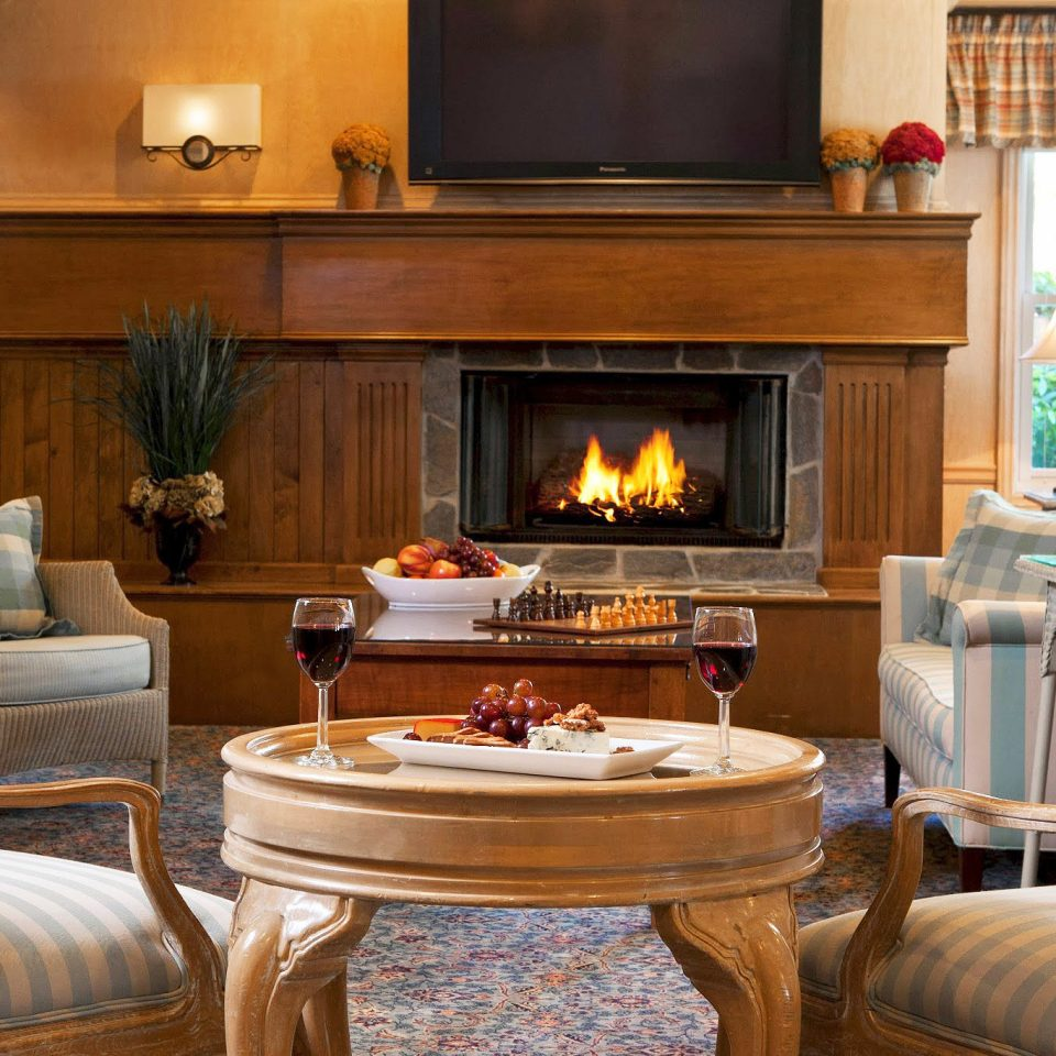 Hip Lounge Luxury Modern Fireplace living room chair property home hardwood cottage cabinetry Suite