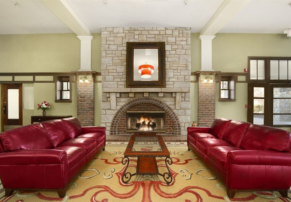 Fireplace Historic Lounge Romantic sofa red living room leather property home recreation room cottage condominium Suite rug