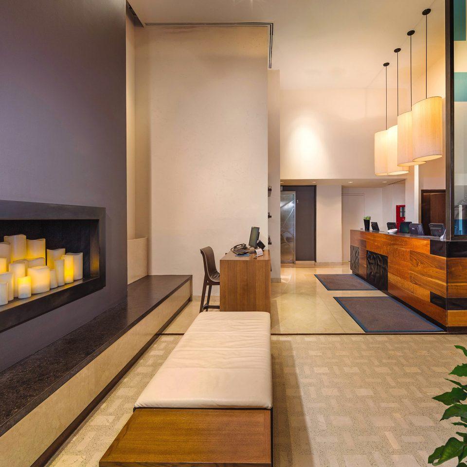 Hotels Lounge Modern Trip Ideas property hearth living room hardwood home Fireplace lighting Lobby wood flooring Suite