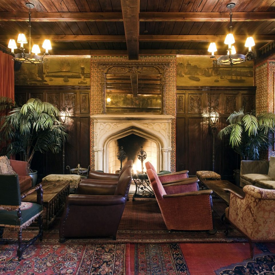 Hotels Trip Ideas property living room chair Lobby home Fireplace mansion rug