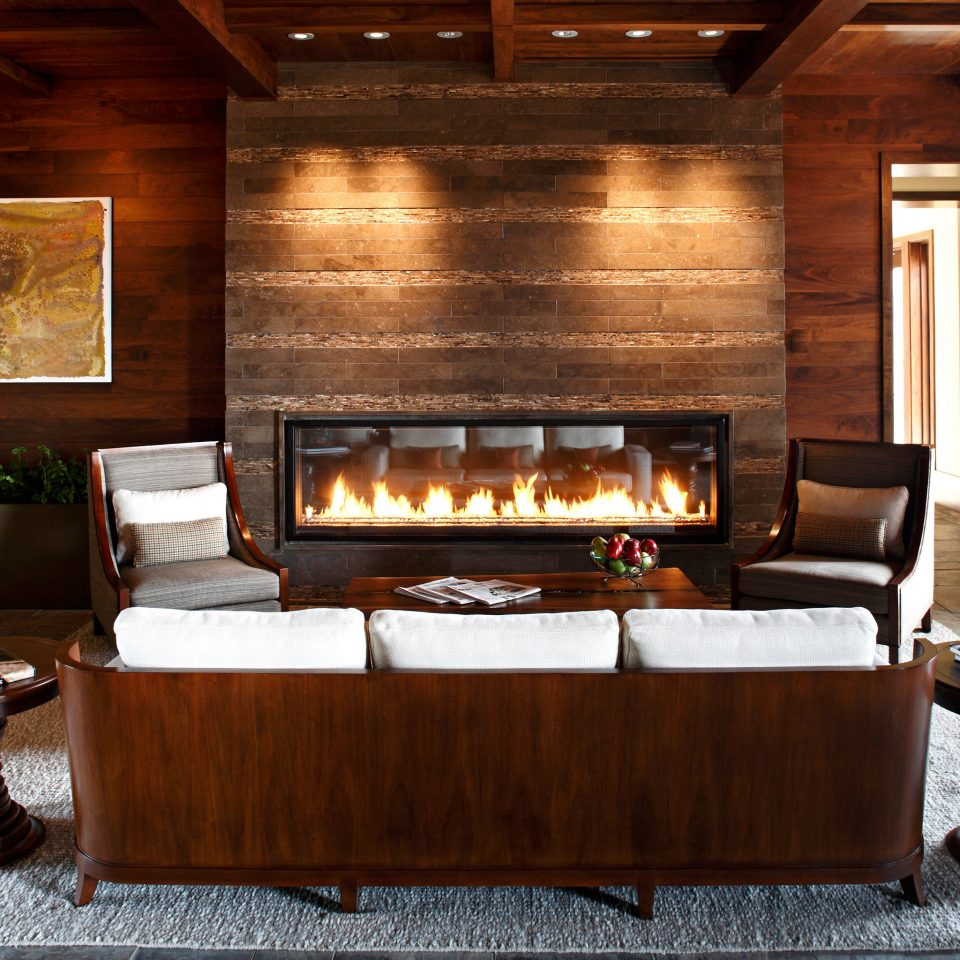 Fireplace Hotels Lounge Modern Romantic man made object hearth living room hardwood wooden home lighting cabinetry wood flooring cuisine cottage stone