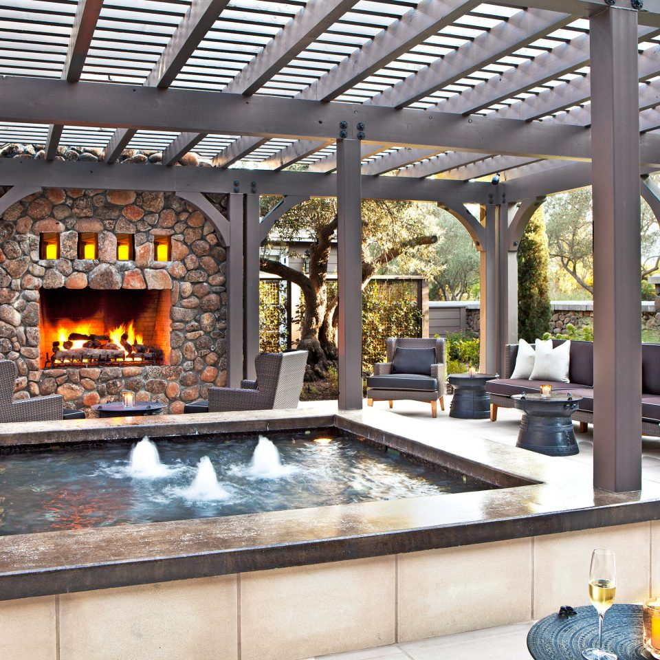 Fireplace Hotels Lounge Outdoors Patio Rustic Trip Ideas building fire property home cottage hearth outdoor structure living room stone