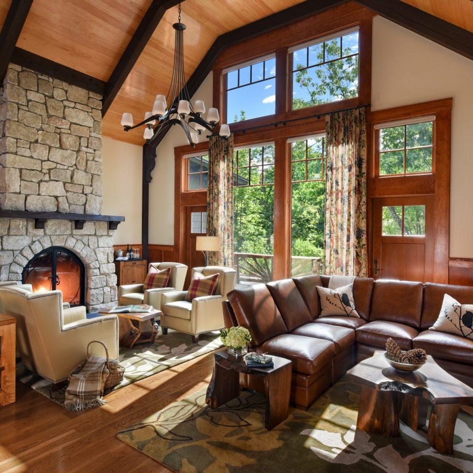 Hotels New York Romantic Hotels sofa living room Fireplace home beam hardwood house interior designer stone