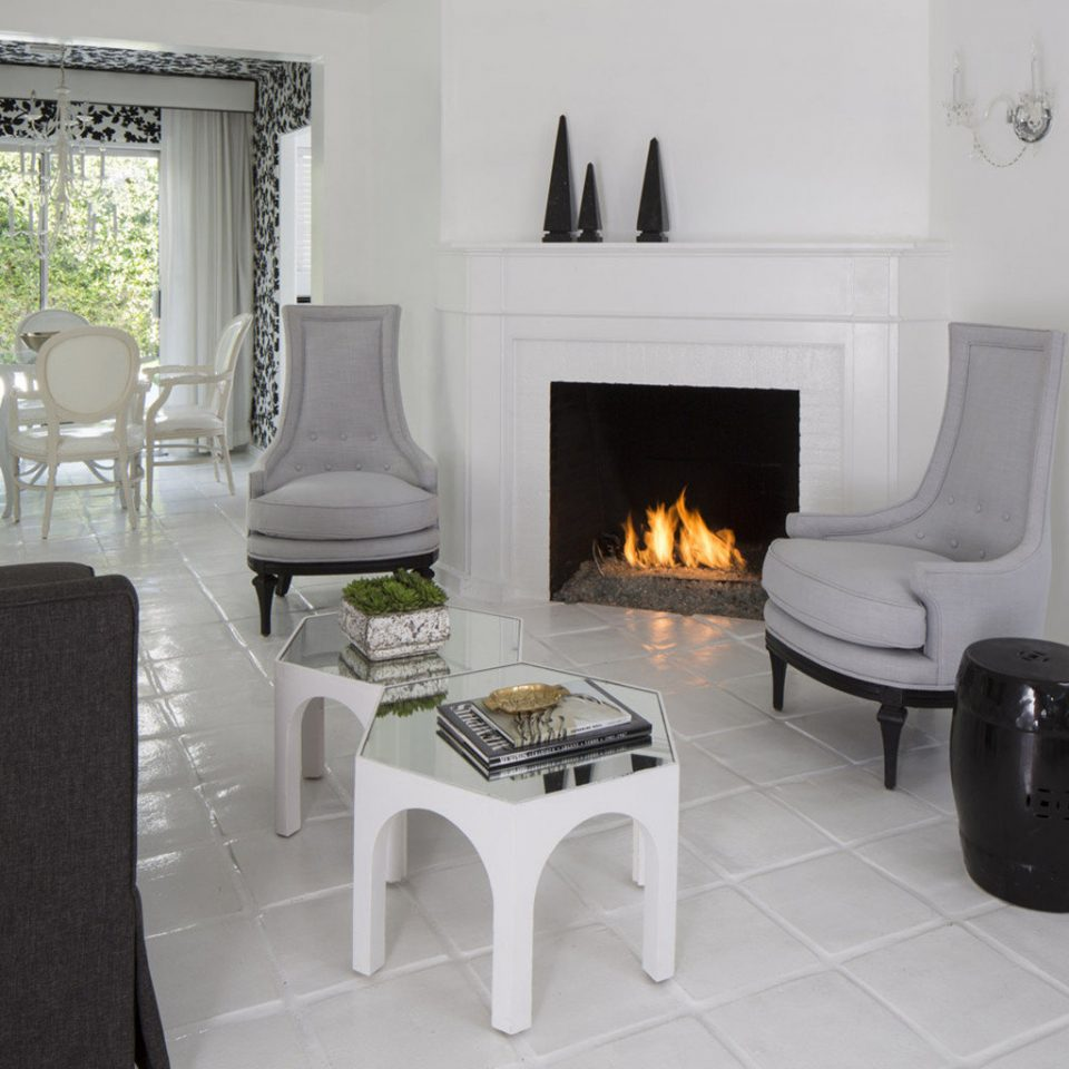 Hotels white living room chair property home house hearth cottage flooring Fireplace Suite Villa