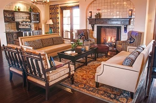 Fireplace Inn Kitchen Winery property living room chair home cottage hardwood Villa mansion condominium farmhouse Suite