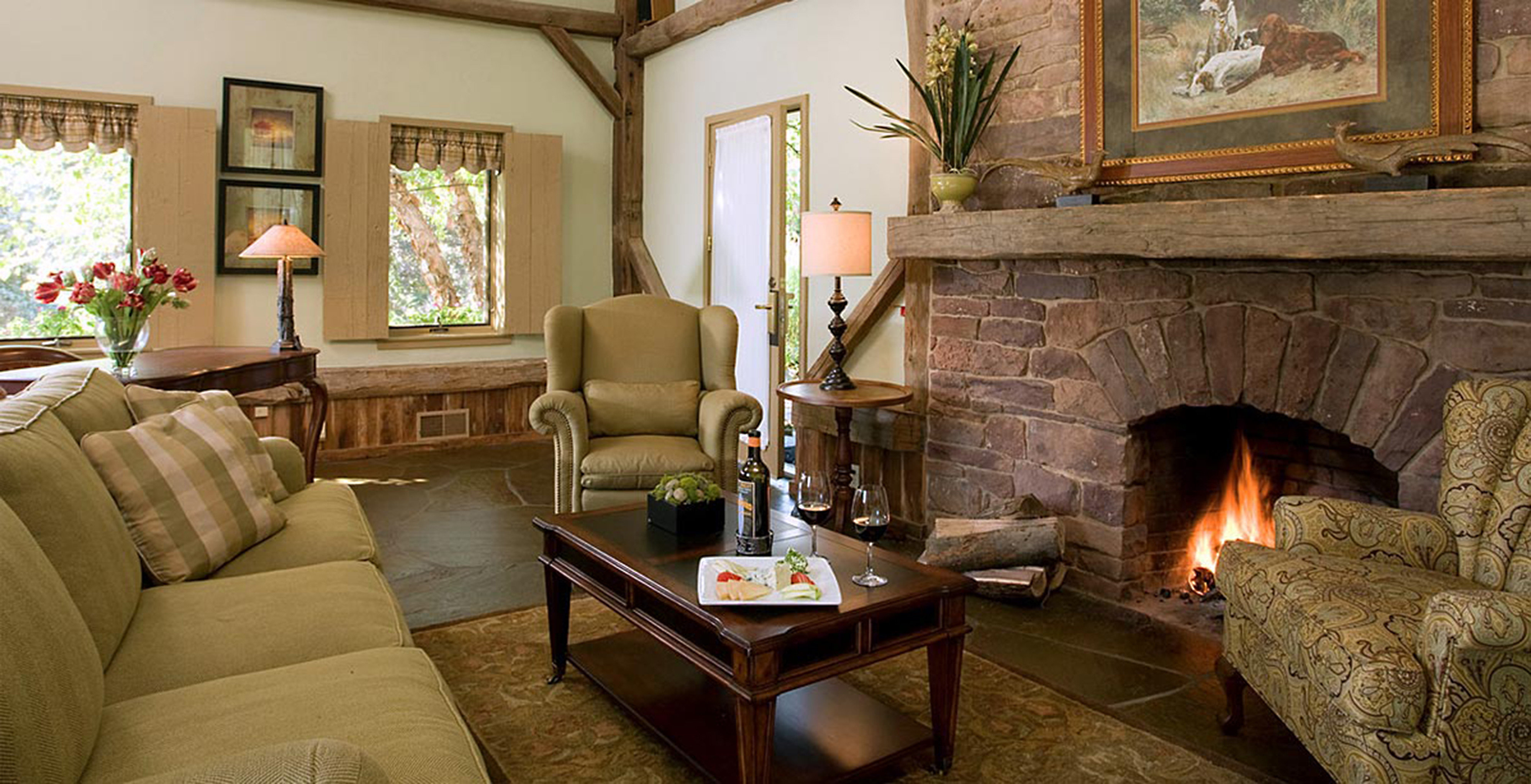 Fireplace Inn Lounge Rustic sofa fire property living room home cottage farmhouse Villa mansion stone