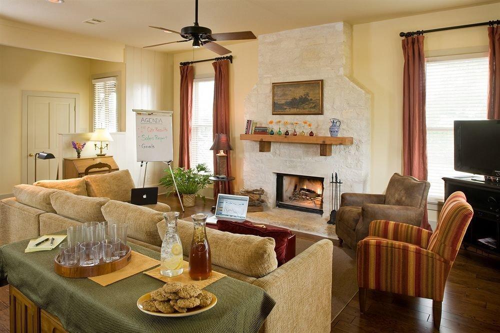 Fireplace Inn Rustic living room property home Suite cottage hardwood Villa condominium farmhouse