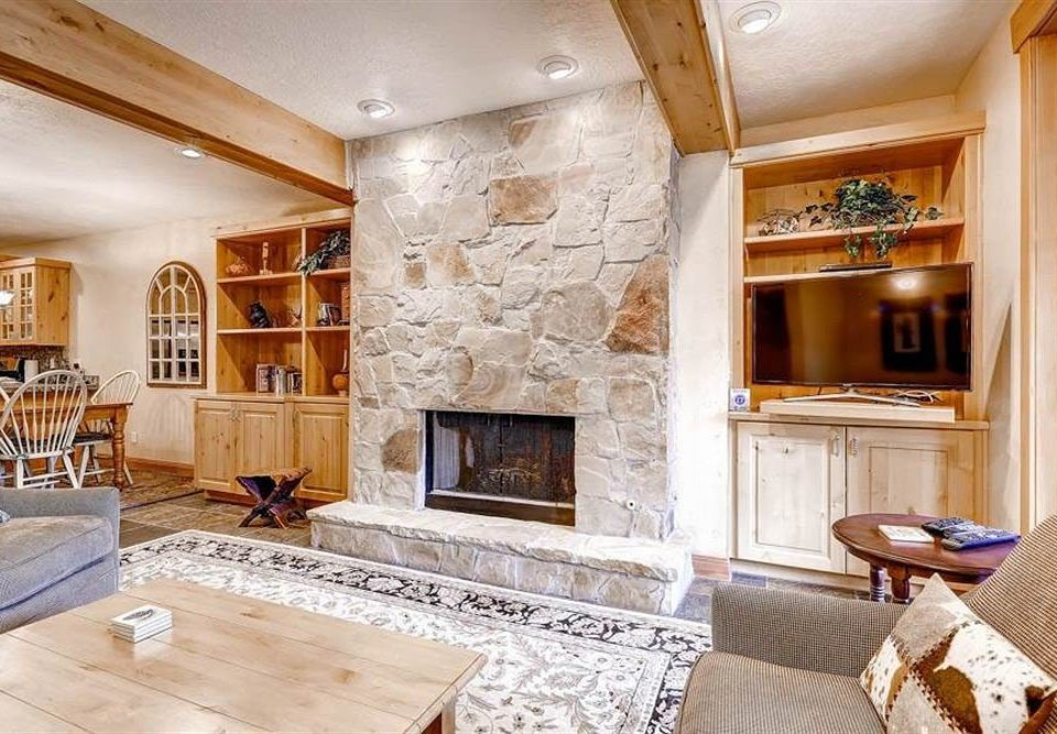 Fireplace property living room fire home hardwood cuisine classique flooring cabinetry mansion cottage wood flooring farmhouse Kitchen stone