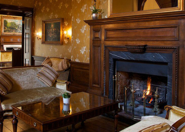 Fireplace fire property home living room hardwood cottage mansion cabinetry Suite Kitchen stone